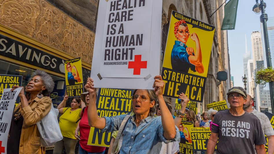 Activists march to the offices of Sens. Chuck Schumer and Kirsten Gillibrand in New York City in September 2017, just before the start of Senate hearings on stabilizing the Affordable Care Act. (Pacific Press/LightRocket via Getty Images)