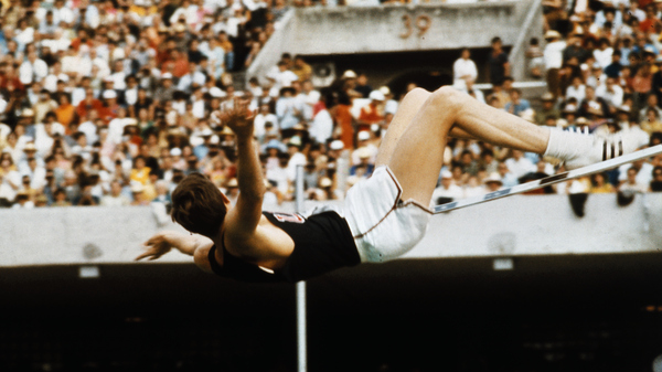 Dick Fosbury set an Olympic record as he cleared the bar in the high jump event at 7 feet, 4 1/4 inches in the 1968 Olympics in Mexico.