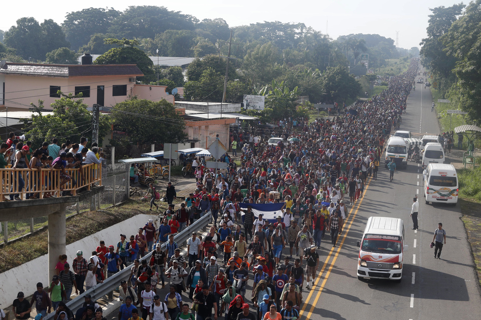 Central American migrants walking to the U.S. start their day departing Ciudad Hidalgo, Mexico, on Sunday. Despite Mexican efforts to stop them at the border, thousands of Central American migrants resumed their advance toward the U.S. border early Sunday in southern Mexico. (Moises Castillo/AP)