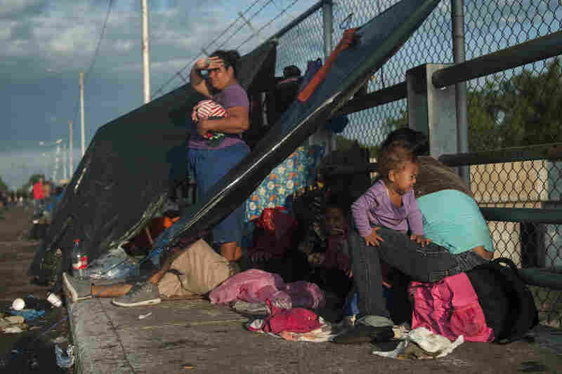 Honduran migrants start their day under improvised tents just across the border Sunday in Tecun Uman, Guatemala. Many of the people who joined the caravan paused in Guatemala or met with Mexican officials to apply for asylum.