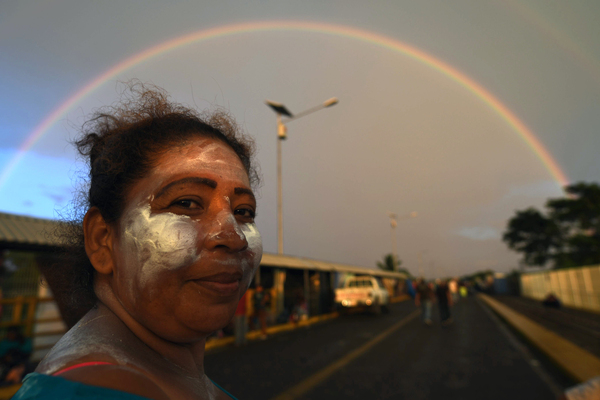 A Honduran migrant waits to cross the border from Ciudad Tecun Uman, Guatemala to Ciudad Hidalgo, Mexico, on Sunday.