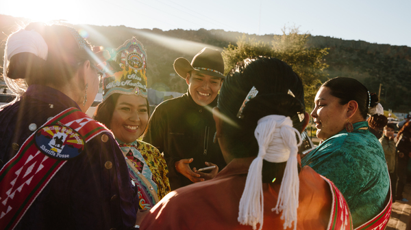 Miss White Mountain Apache Queen 2018-19 Zipporah Lupe greets Miss Navajo contestands Summer Jake (left), Kayla Martinez and Autumn Montoya as they get ready for the parade at the 77th Navajo Nation Fair in Window Rock, Ariz. on the Navajo Nation in September.
