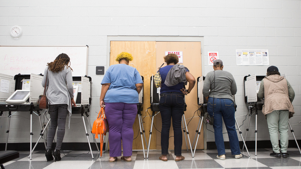 Voters cast ballots during early voting last week at C.T. Martin Natatorium and Recreation Center in Atlanta. Georgia has blocked approximately 53,000 voter registrations.