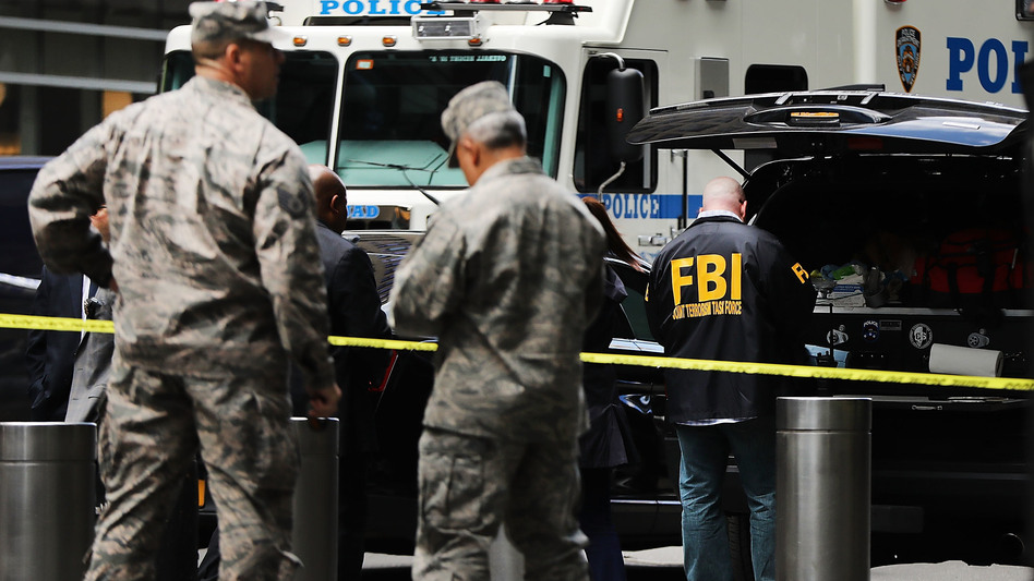 Police, FBI and other emergency workers gather outside the Time Warner Center in New York City after an explosive device was found Wednesday morning at CNN's office in the building. (Spencer Platt/Getty Images)