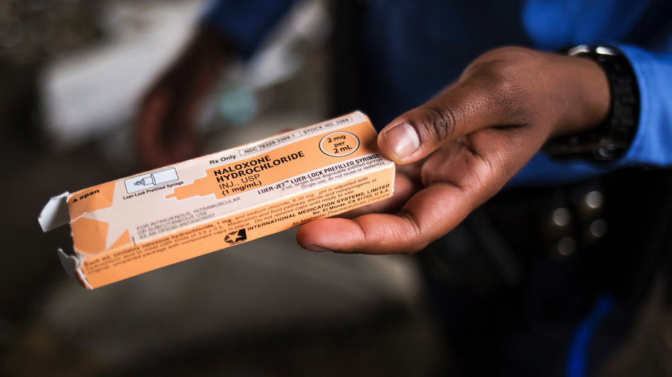 A Philadelphia police officer holds a package of the overdose antidote naloxone while on patrol in the Kensington neighborhood of Philadelphia in April 2017.