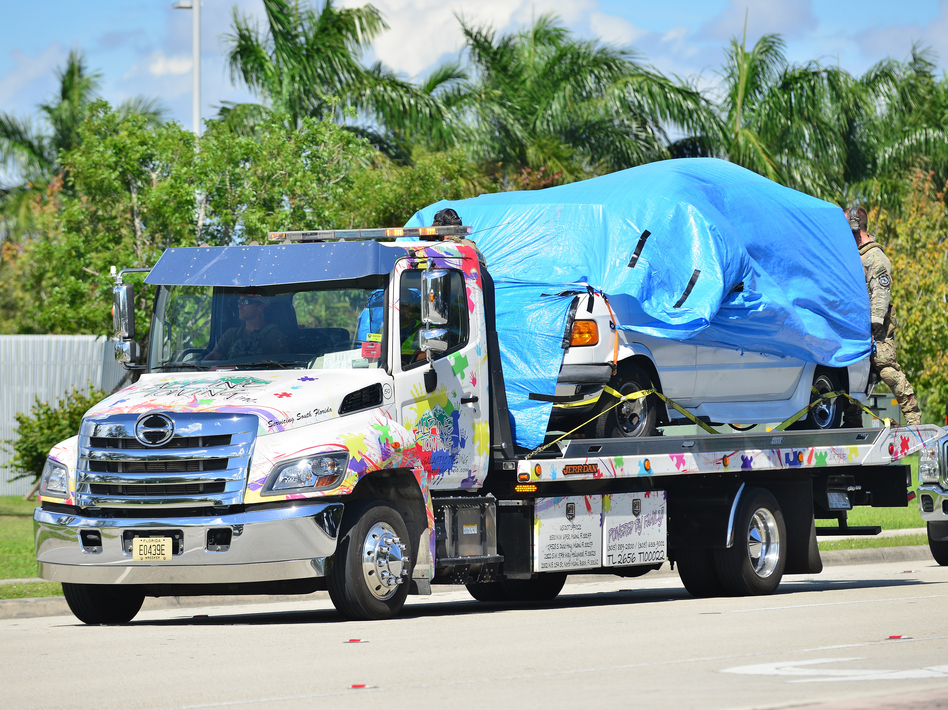 A van belonging to Cesar Sayoc covered in blue tarp was towed by FBI investigators to FBI Miramar Headquarters. The suspect was arrested in connection to the string of pipe bombs mailed to prominent Democrats across the country. (Johnny Louis/Getty Images)