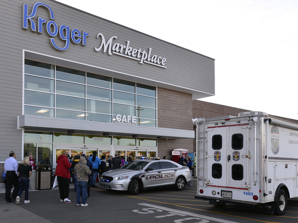 The scene outside a Kroger supermarket following a shooting that left two people dead last Wednesday in Jeffersontown, Ky. Many have labeled the attack a hate crime. (Timothy D. Easley/AP)