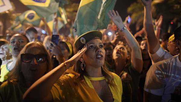 A supporter of Jair Bolsonaro salutes during a celebration in front of his residence after he was declared the winner of the election runoff, in Rio de Janeiro, Brazil, on Sunday.