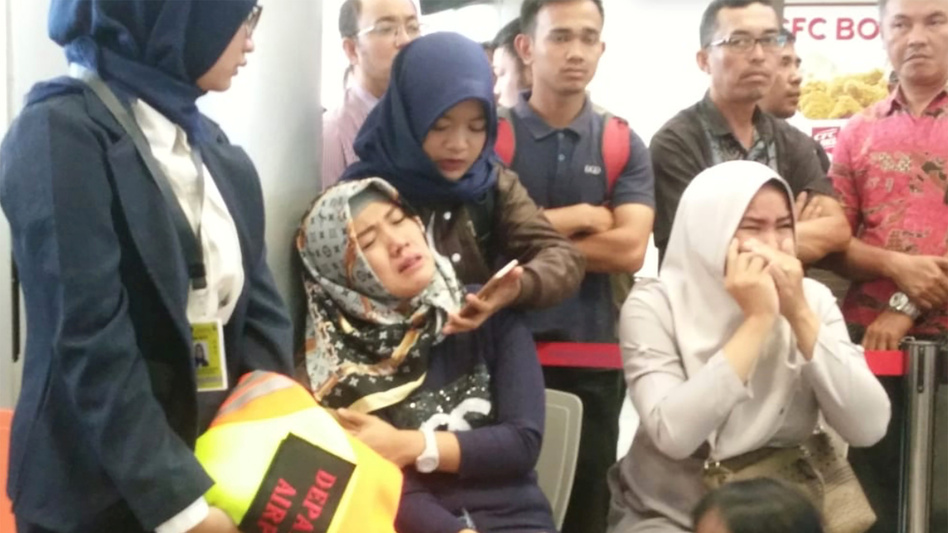 Relatives of passengers of Lion Air flight JT610 that crashed into the sea cry at the airport on Monday in Pangkal Pinang, Indonesia, where the plane was bound. (Antara Foto Agency/Reuters)