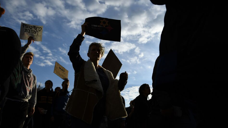 People protest the arrival of President Trump as he visits the Tree of Life synagogue in Pittsburgh on Tuesday. Many Americans fear more violence in U.S. political life. (Brendan Smialowski/AFP/Getty Images)