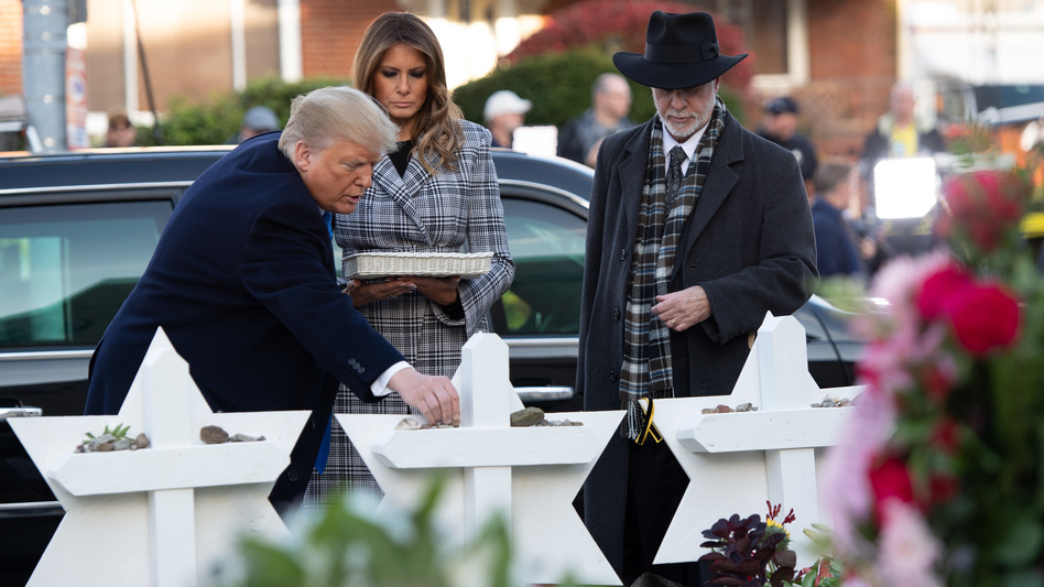President Trump and first lady Melania Trump, alongside Rabbi Jeffrey Myers, place stones on a memorial as they pay their respects at the Tree of Life Synagogue in Pittsburgh on Tuesday. (Saul Loeb/AFP/Getty Images)