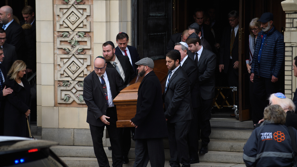 Pallbearers carry the caskets of brothers Cecil Rosenthal, 59, and David Rosenthal, 54, on Tuesday in Pittsburgh, Pa. The brothers were among 11 killed in the mass shooting at the Tree of Life Synagogue last Saturday. (Jeff Swensen/Getty Images)