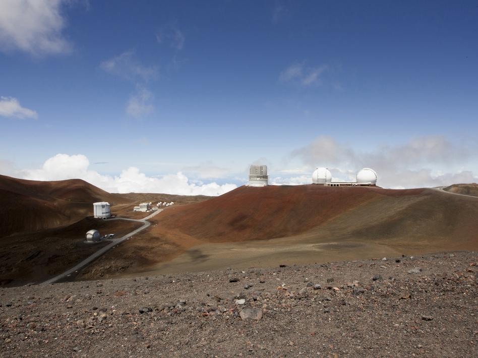 Telescopes on the summit of Mauna Kea on Hawaii's Big Island. Some native Hawaiians consider Mauna Kea sacred and object to construction of a new giant telescope there. (Caleb Jones/AP)