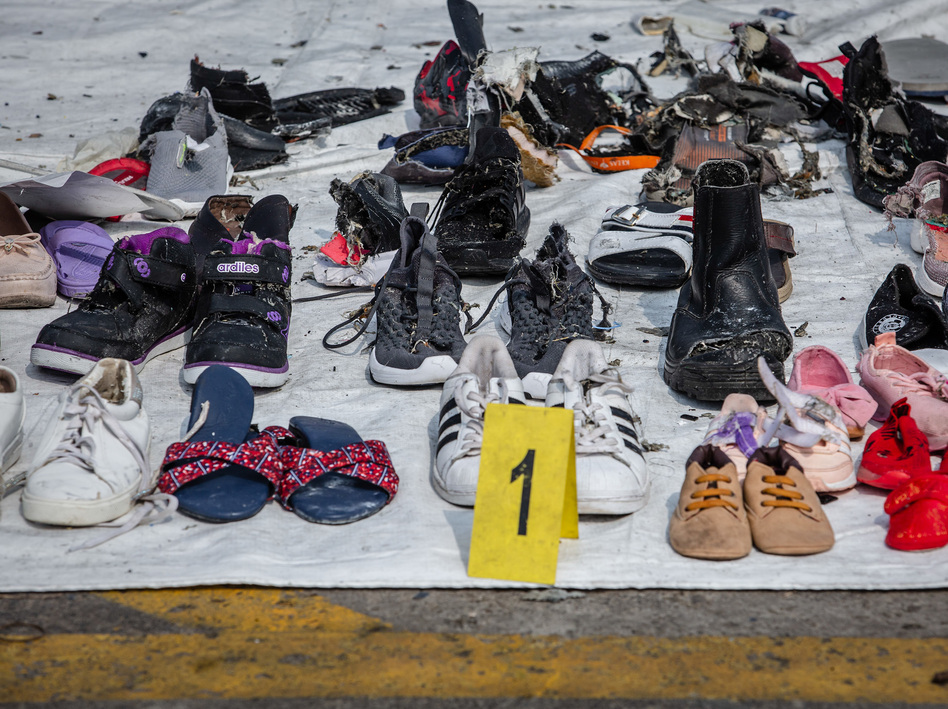 Personal items recovered from Lion Air flight JT610 by search-and-rescue personnel at the Tanjung Priok port on Wednesday in Jakarta. (Ulet Ifansasti/Getty Images)