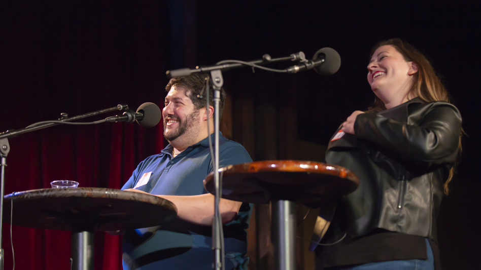 Contestants Avi Zacherman and Lauren MacDonough appear on <em>Ask Me Another</em> at the Bell House in Brooklyn, New York