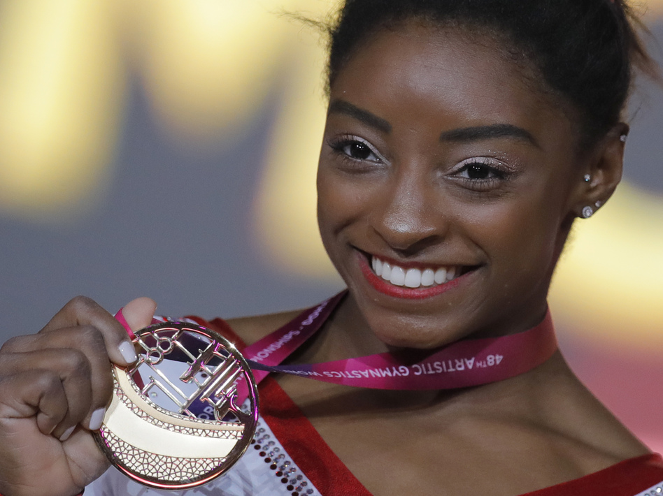 Simone Biles of the U.S. shows her gold medal after the women's vault final at the gymnastics World Championships in Doha, Qatar, last week. (Vadim Ghirda/AP)