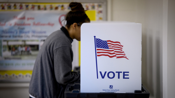 A woman votes Tuesday in Cambridge, Ohio. More than a dozen races were decided by a single vote or ended in a tie over the last 20 years.
