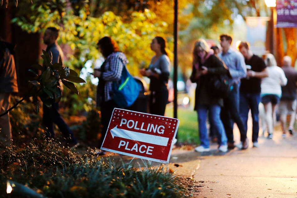 More than 47 percent of the voting-eligible population cast a ballot in the midterm elections on Tuesday according to early estimates from the United States Election Project. (David Goldman/AP)