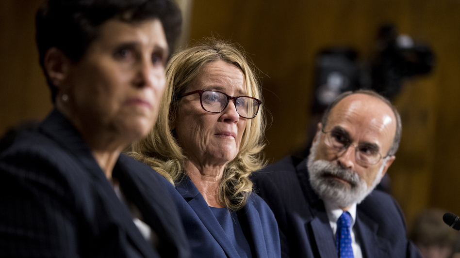 Christine Blasey Ford (center), flanked by attorneys Debra Katz and Michael Bromwich. The attorneys say that although Ford has tried to return to her life, she endures harassment.