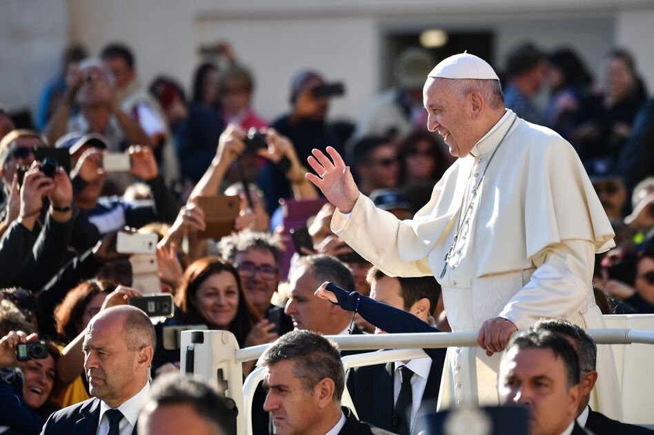 Pope Francis greets the crowd in the Vatican's St. Peter's Square in October. Many of the pope's most vocal opponents are in the United States, attacking him in tweets, blogs and politically conservative media. (Alberto Pizzoli/AFP/Getty Images)