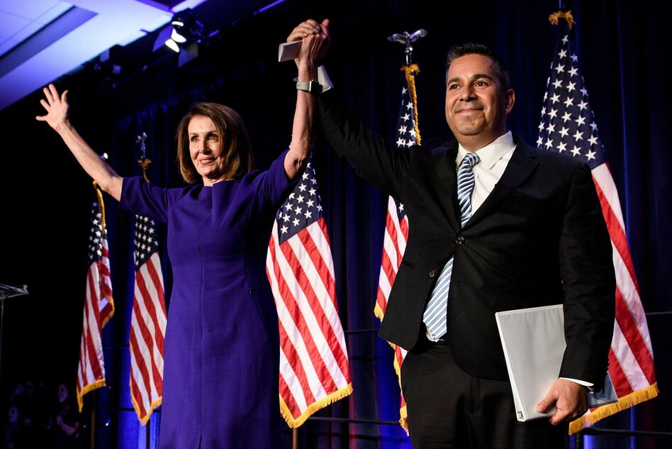 House Democratic Leader Nancy Pelosi, D-Calif., and Rep. Ben Ray Lujan, D-N.M., Democratic Congressional Campaign Committee chairman, celebrate. (Brendan Smialowski/AFP/Getty Images)