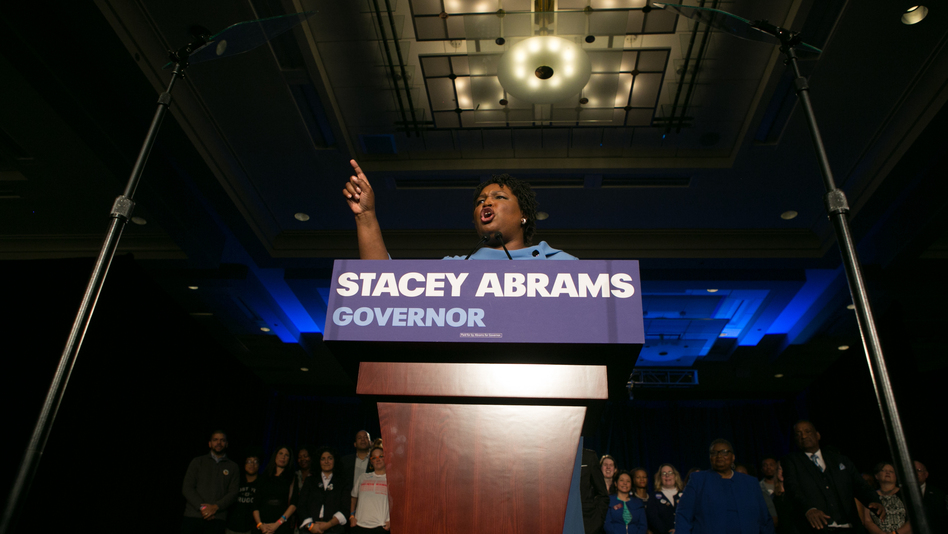 Stacey Abrams addresses her supporters at an election watch party early Wednesday in Atlanta. She and her opponent, Republican Brian Kemp, are locked in a gubernatorial race that remains too close to call. (Jessica McGowan/Getty Images)