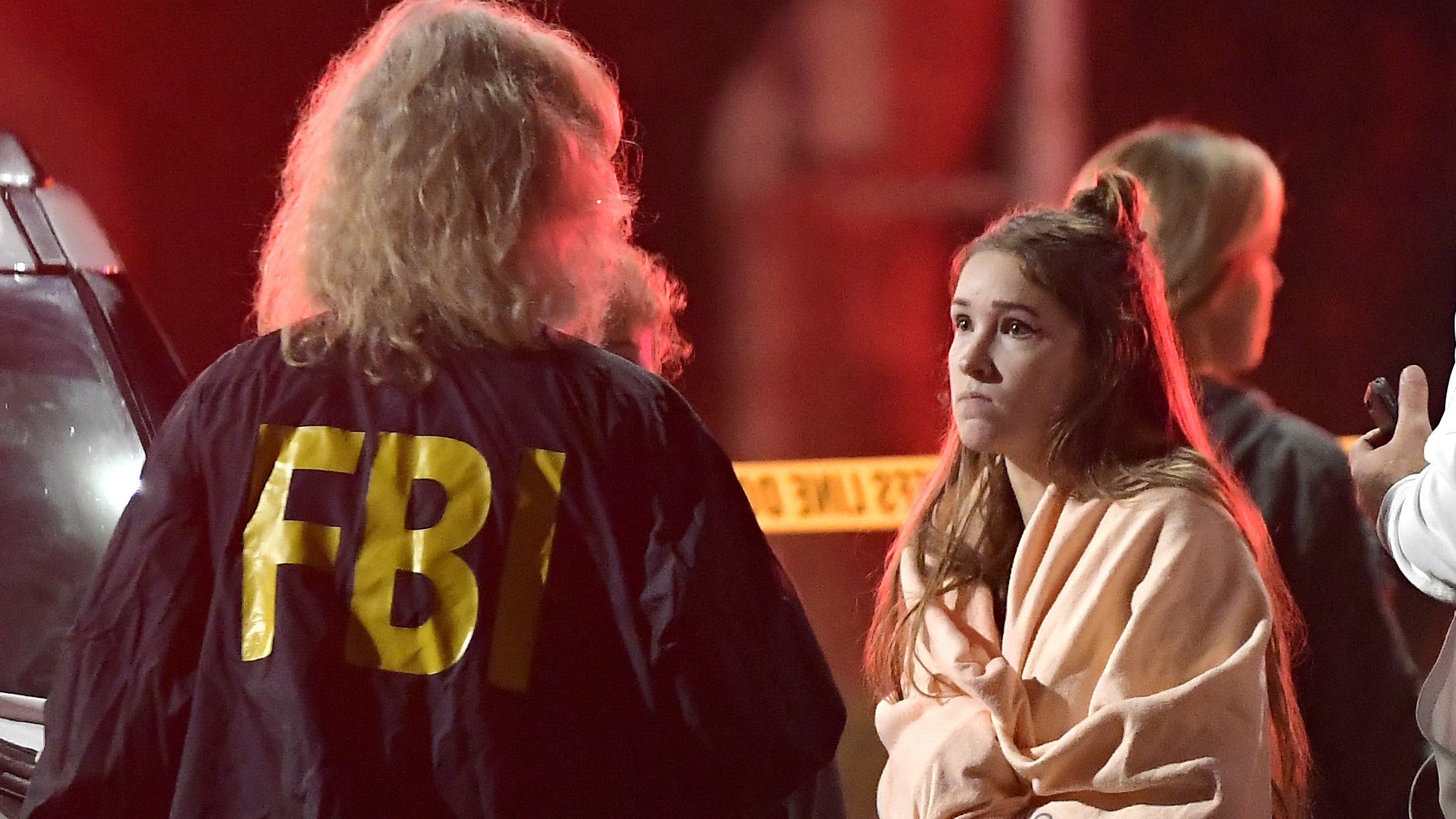 "An FBI agent talks to a potential witness to the shooting at the Borderline Bar & Grill in Thousand Oaks, Calif., where a gunman opened fire inside the country dance bar on ""College Country Night."""