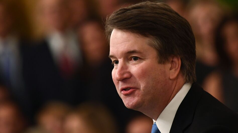 Brett Kavanaugh, pictured after he was sworn in at the White House last month, formally took his seat as the 114th justice during the traditional investiture ceremony at the U.S. Supreme Court on Thursday morning. (Brendan Smialowski/AFP/Getty Images)