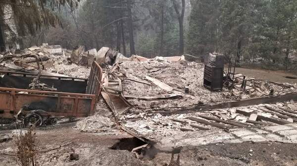 A property burned by the Camp Fire in Northern California. Authorities are releasing photos as they ask residents to be patient and understand why they can't enter the fire zone yet.
