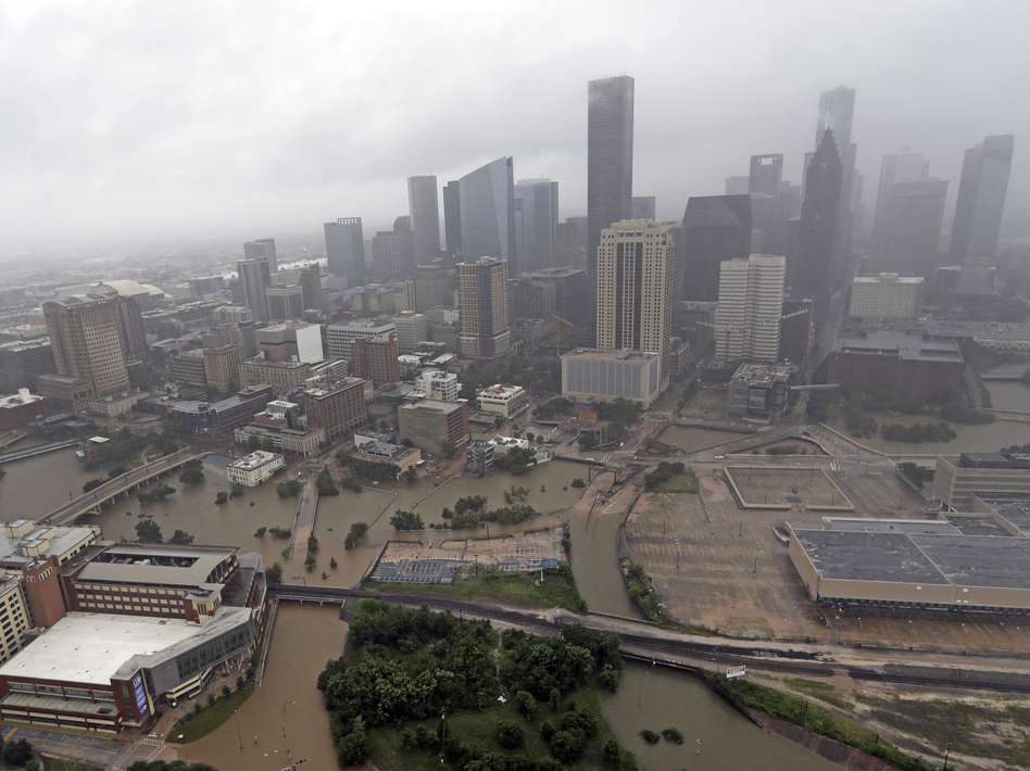 Downtown Houston flooded by rain from Hurricane Harvey on Aug. 29, 2017. The buildings in the region exacerbated rainfall from the storm, according to a new study. (David J. Phillip/AP)