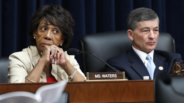 Rep. Maxine Waters, seated next to Rep. Jeb Hensarling of Texas, at a hearing in July, is set to become chair of the House Financial Services Committee.