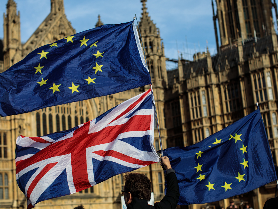 Demonstrators gather Tuesday to protest Brexit outside Parliament in London. They wave the Union Jack and the flag of the European Union. (Jack Taylor/Getty Images)