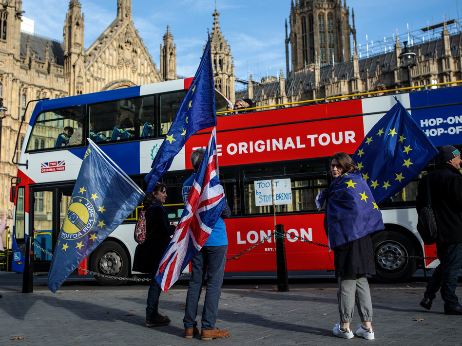 Pro-European Union protesters demonstrate against Brexit outside the House of Parliament on Tuesday in London, as Prime Minister Theresa May was reaching an agreement with the EU. (Jack Taylor/Getty Images)