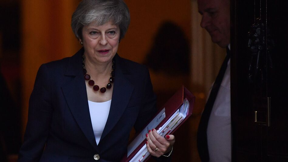 British Prime Minister Theresa May faces the difficult task of persuading skeptical Brits to get on board with a tentative agreement with European Union negotiators. (Ben Stansall/AFP/Getty Images)