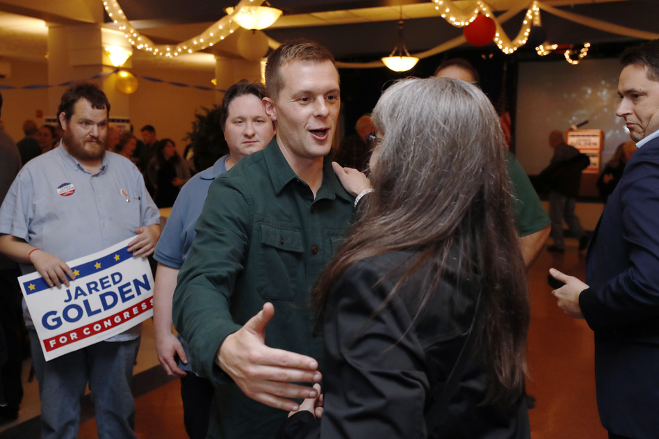 Democrat Jared Golden greets supporters as they wait on Election Day in Lewiston, Maine. Golden was declared the winner on Thursday as a result of the state's new ranked-choice voting system. (Joel Page/AP)