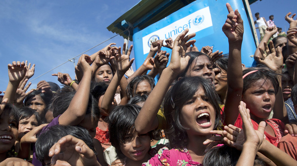 Rohingya refugee children shout slogans during a protest against the repatriation process on Thursday at Unchiprang refugee camp near Cox