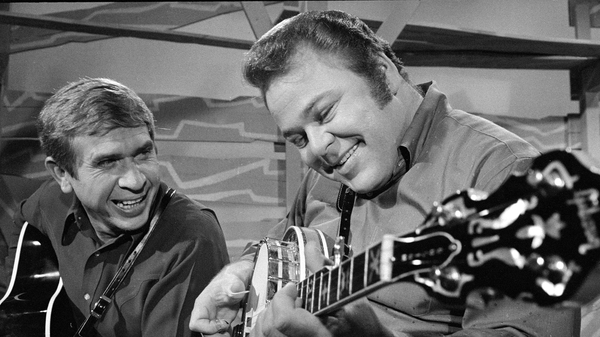 Hee Haw co-hosts Roy Clark (right) and Buck Owens in 1969. Clark died Thursday at the age of 85.