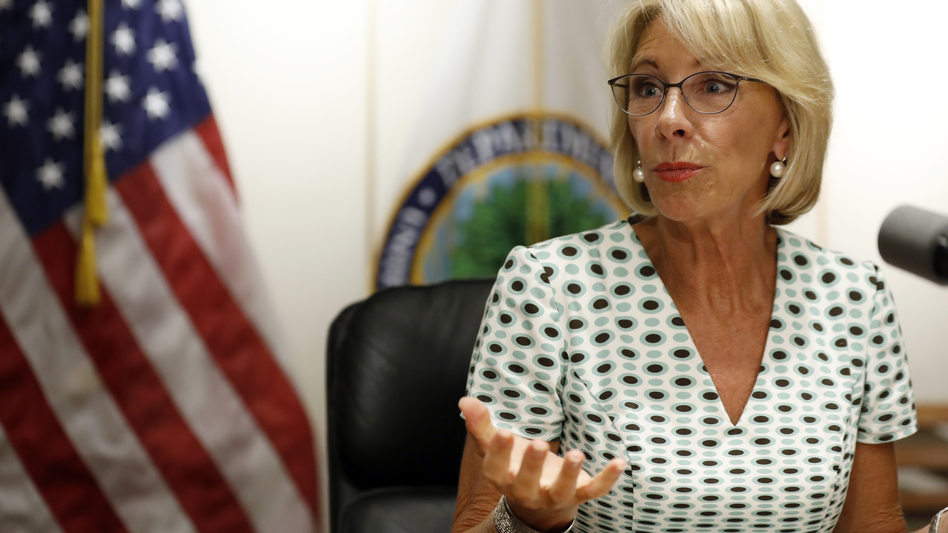 Education Secretary Betsy DeVos speaks with the media after a series of listening sessions about campus sexual violence in July 2017. Among the significant changes is that schools can make it harder to prove allegations. (Alex Brandon/AP)