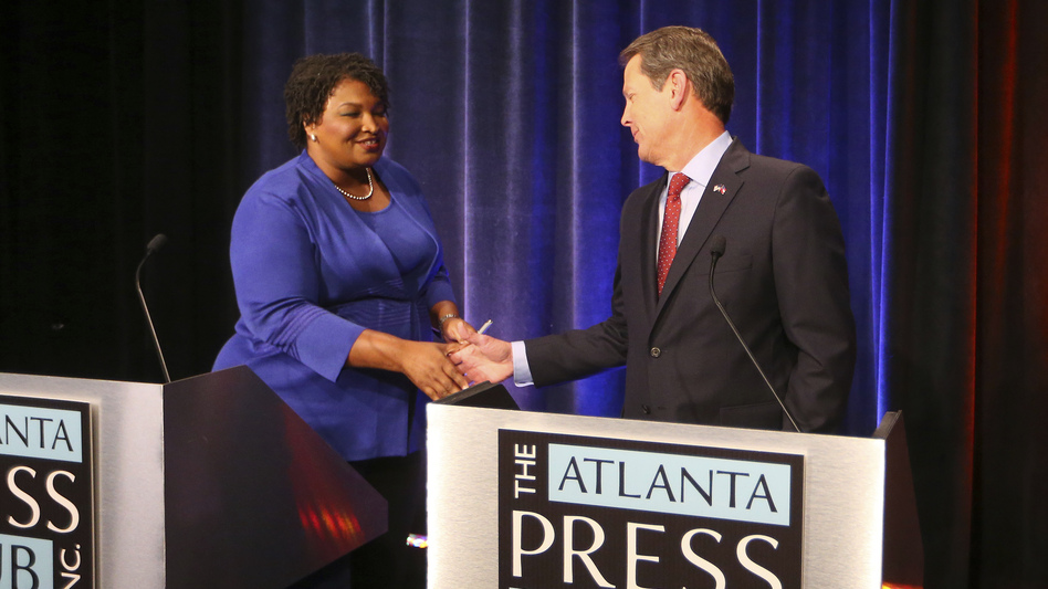 Democrat Stacey Abrams and Republican Brian Kemp greet each other before a debate last month in Atlanta. (John Bazemore/AP)