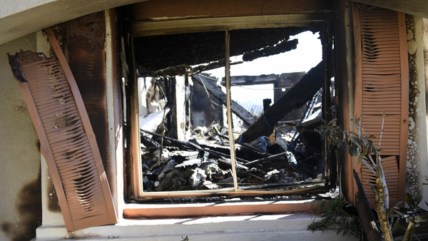 The wreckage of a house sitting in Thousand Oaks, Calif., a city ravaged by the Woolsey Fire less than a day after a mass shooting.