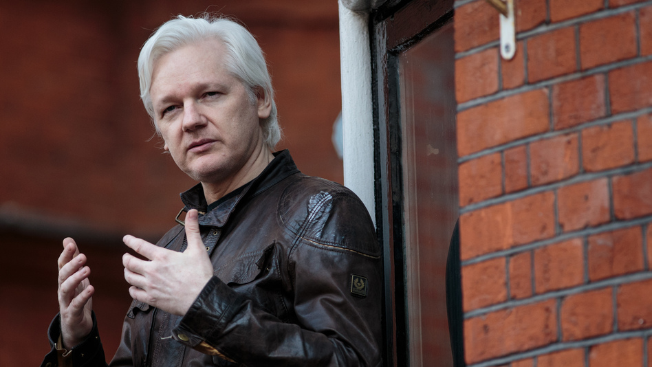Julian Assange speaks to the media from the balcony of the Ecuadorian Embassy in London last year. (Jack Taylor/Getty Images)
