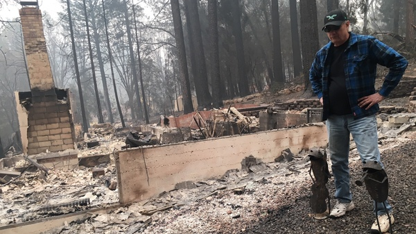 Jim Knaver at the site of his burned home in Paradise, Calif.