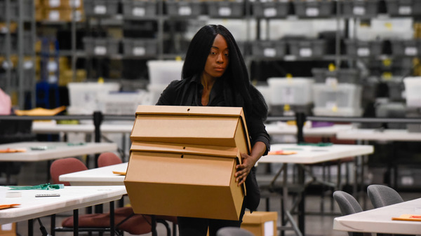 A woman sets up tables for hand-counting ballots in Palm Beach County on Thursday.