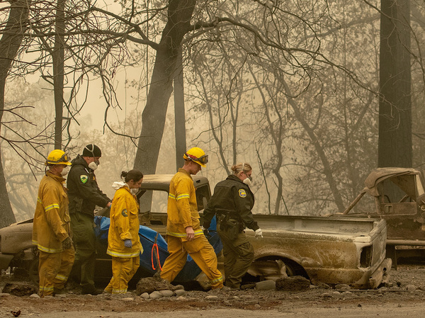 Rescue workers carry a body away from a burned property in Paradise, Calif., on Nov. 14.