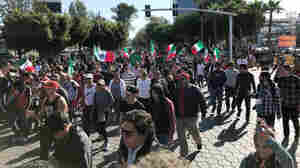 Shouting 'Mexico First,' Hundreds In Tijuana March Against Migrant Caravan