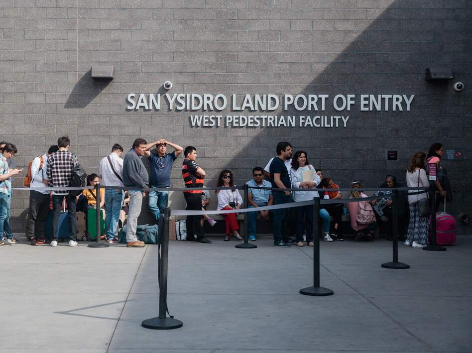People wait in line outside the San Ysidro Port of Entry, between Tijuana, Mexico, and San Diego, Calif., in October. (Ariana Drehsler/AFP/Getty Images)