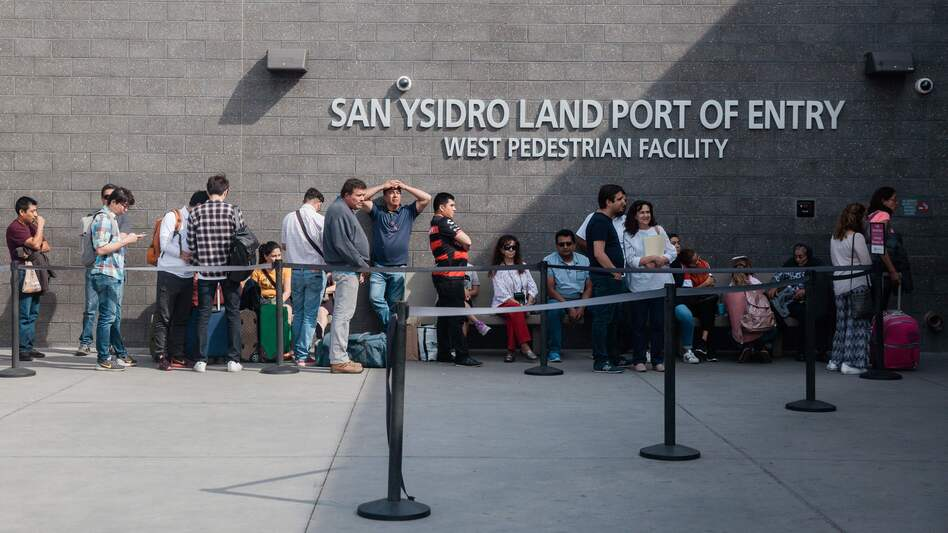 People wait in line outside the San Ysidro Port of Entry, between Tijuana, Mexico, and San Diego, Calif., in October.