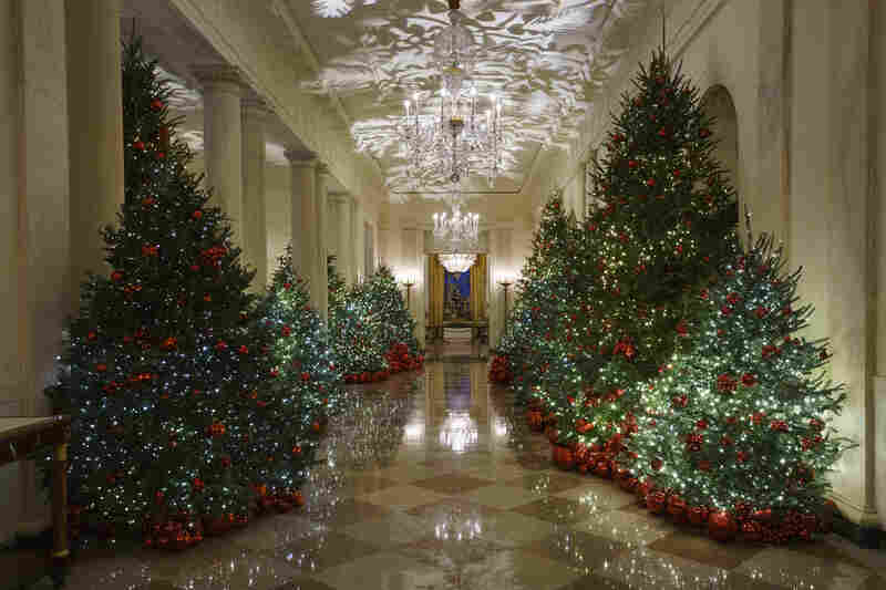 The Grand Foyer and Cross Hall has 29 trees with more than 14,000 red ornaments and plenty of twinkling lights.