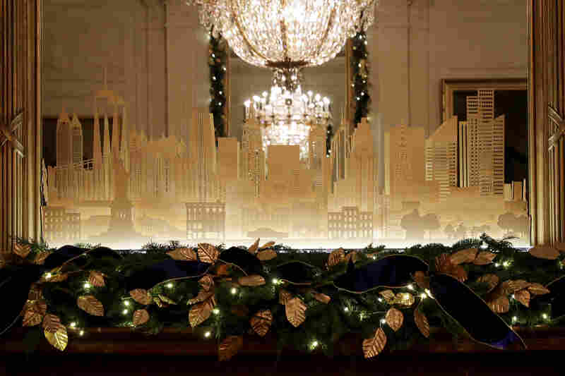 Holiday decorations in the East Room celebrate American architecture and design with a custom mantelpiece of the New York City skyline.