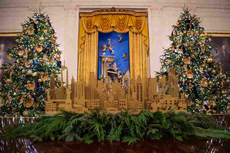 "Decorations in the East Room are meant to show the ""diversity and ingenuity of American architecture and design"" — and include four custom mantelpieces that depict the skylines of St. Louis, Chicago, San Francisco and New York City."